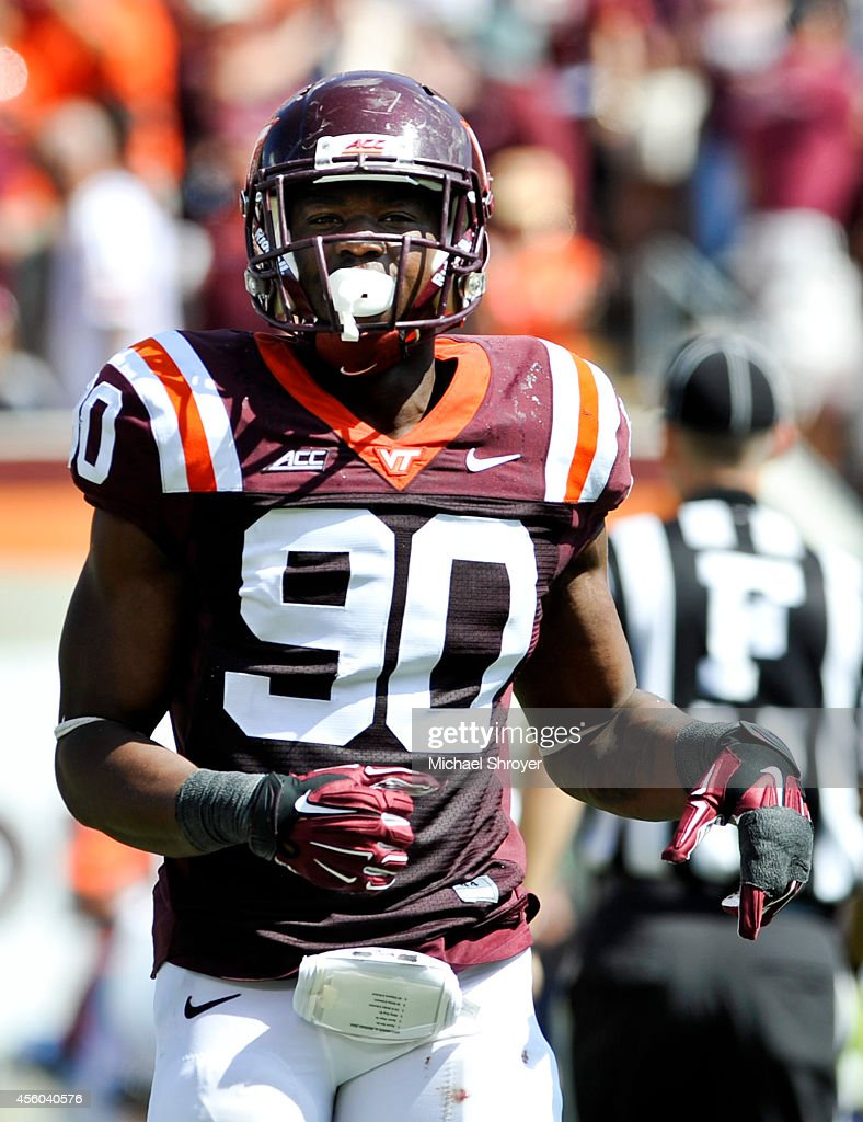 Defensive end <a gi-track='captionPersonalityLinkClicked' href=/galleries/search?phrase=Dadi+Nicolas&family=editorial&specificpeople=8599685 ng-click='$event.stopPropagation()'>Dadi Nicolas</a> #90 of the Virginia Tech Hokies jogs off the field after a defensive play against the Georgia Tech Yellow Jackets in the second half at Lane Stadium on September 20, 2014 in Blacksburg, Virginia. Georgia Tech defeated Virginia Tech 27-24.