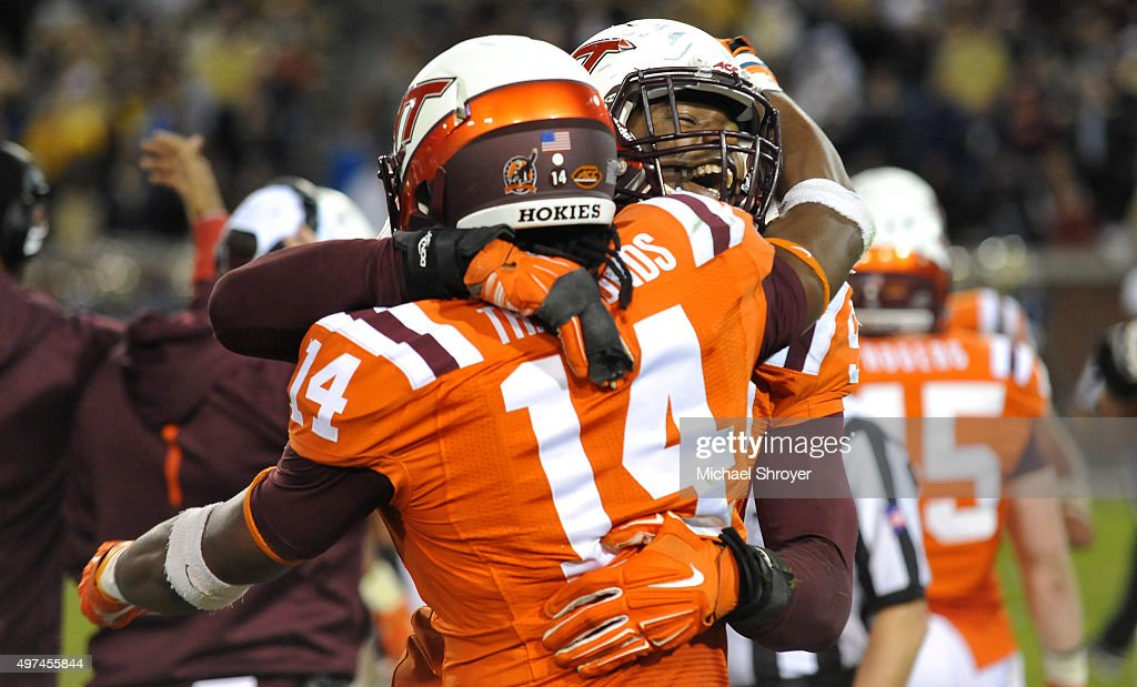 Defensive end <a gi-track='captionPersonalityLinkClicked' href=/galleries/search?phrase=Dadi+Nicolas&family=editorial&specificpeople=8599685 ng-click='$event.stopPropagation()'>Dadi Nicolas</a> #90 of the Virginia Tech Hokies reacts with running back Trey Edmunds #14 in the second half against the Georgia Tech Yellow Jackets at Bobby Dodd Stadium on November 12, 2015 in Atlanta, Georgia. Virginia Tech defeated Georgia Tech 23-21.