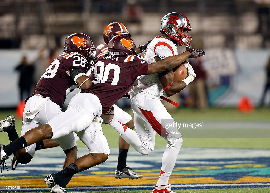 Defensive end Dadi Nicolas #90 of the Virginia Tech Hokies tackles receiver Brandon Coleman #17 of the Rutgers Scarlet Knights during the Russell Athletic Bowl Game at the Florida Citrus Bowl on December 28, 2012 in Orlando, Florida.