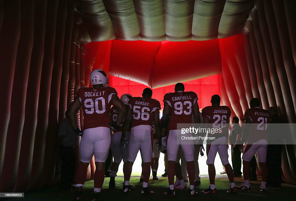 Defensive end <a gi-track='captionPersonalityLinkClicked' href=/galleries/search?phrase=Darnell+Dockett&family=editorial&specificpeople=240273 ng-click='$event.stopPropagation()'>Darnell Dockett</a> #90, inside linebacker Karlos Dansby #56, defensive end <a gi-track='captionPersonalityLinkClicked' href=/galleries/search?phrase=Calais+Campbell&family=editorial&specificpeople=2109853 ng-click='$event.stopPropagation()'>Calais Campbell</a> #93, free safety <a gi-track='captionPersonalityLinkClicked' href=/galleries/search?phrase=Rashad+Johnson&family=editorial&specificpeople=3941326 ng-click='$event.stopPropagation()'>Rashad Johnson</a> #26 and cornerback Patrick Peterson #21 of the Arizona Cardinals wait to take the field before the NFL game against the Atlanta Falcons at the University of Phoenix Stadium on October 27, 2013 in Glendale, Arizona. The Cardinals defeated the Falcons 27-13.