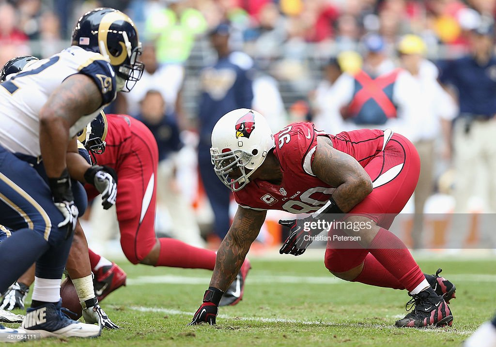 Defensive end <a gi-track='captionPersonalityLinkClicked' href=/galleries/search?phrase=Darnell+Dockett&family=editorial&specificpeople=240273 ng-click='$event.stopPropagation()'>Darnell Dockett</a> #90 of the Arizona Cardinals in action during the NFL game against the St. Louis Rams at the University of Phoenix Stadium on December 8, 2013 in Glendale, Arizona. The Cardinals defeated the Rams 30-10.