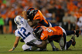 Defensive end DeMarcus Ware of the Denver Broncos and defensive end Malik Jackson of the Denver Broncos combine to sack quarterback Andrew Luck of...