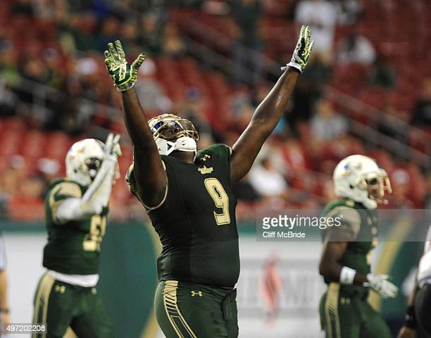 Defensive end Demetrius Hill of the South Florida Bulls celebrates a defensive play against the Temple Owls in the second half at Raymond James...