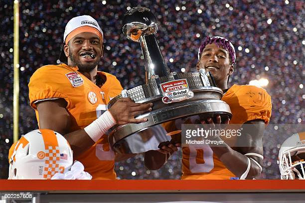 Defensive end Derek Barnett and defensive back Justin Martin of the Tennessee Volunteers celebrate with the trophy following their victory against...