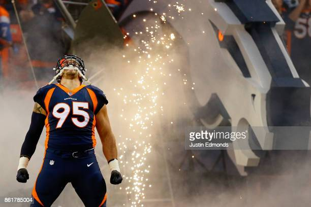 Defensive end Derek Wolfe of the Denver Broncos is introduced to the crowd before a game against the New York Giants at Sports Authority Field at...