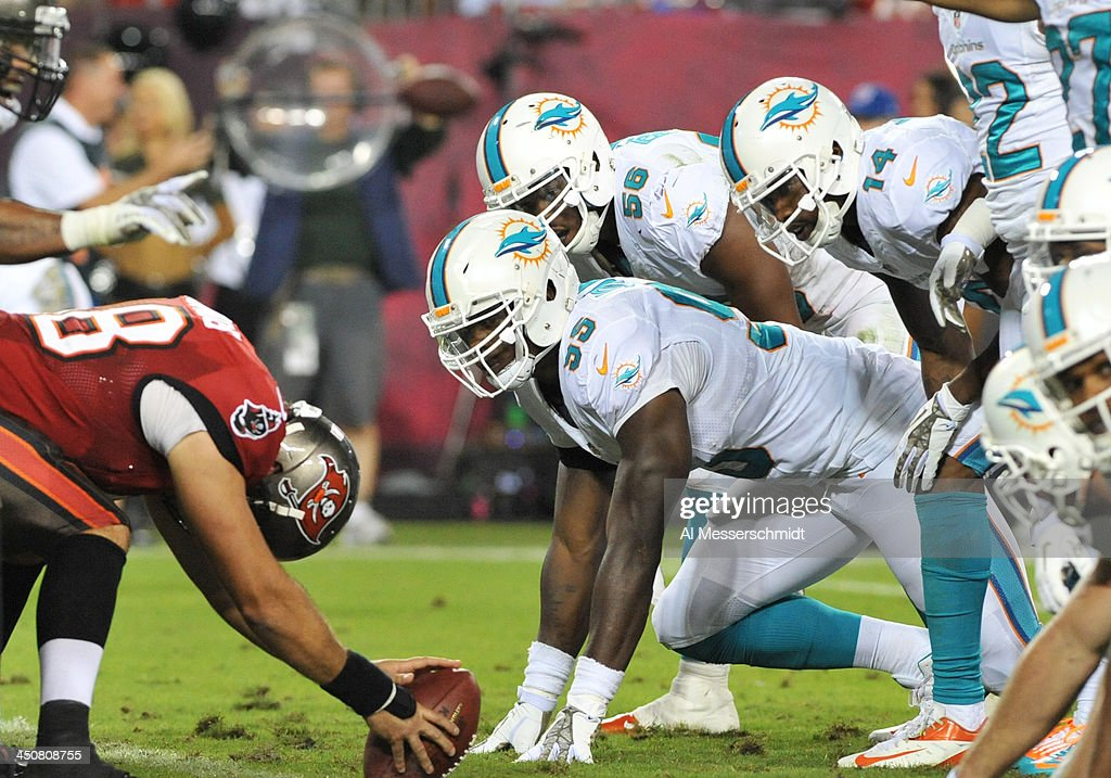 Defensive end <a gi-track='captionPersonalityLinkClicked' href=/galleries/search?phrase=Dion+Jordan&family=editorial&specificpeople=6161243 ng-click='$event.stopPropagation()'>Dion Jordan</a> #95 of the Miami Dolphins sets on defense against the Tampa Bay Buccaneers November 11, 2013 at Raymond James Stadium in Tampa, Florida.