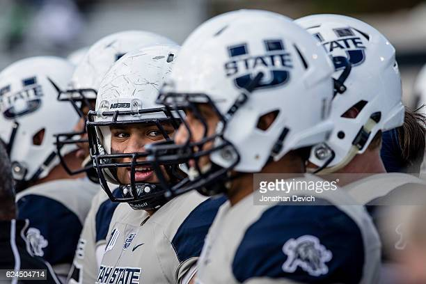 Defensive end Edmund Faimalo of the Utah State Aggies waits to head back to the field to play against the Nevada Wold Pack at Mackay Stadium on...