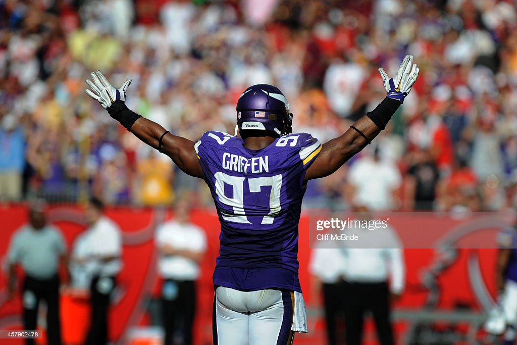 Defensive end Everson Griffen #97 of the Minnesota Vikings celebrates their win against the Tampa Bay Buccaneers in overtime at Raymond James Stadium on October 26, 2014 in Tampa, Florida.