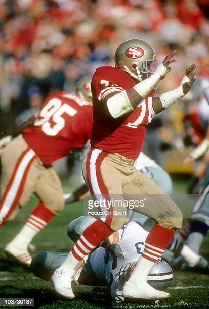 Defensive end Fred Dean of the San Francisco 49ers pursues the play against the Dallas Cowboys during an NFL football game December 19 1983 at...