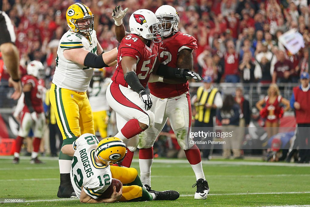 Defensive end Frostee Rucker #92 and inside linebacker Kenny Demens #54 of the Arizona Cardinals react to a sack on quarterback Aaron Rodgers #12 of the Green Bay Packers during the NFL game at the University of Phoenix Stadium on December 27, 2015 in Glendale, Arizona. The Cardinals defeated the Packers 38-8.