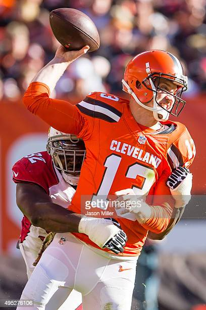 Defensive end Frostee Rucker of the Arizona Cardinals sacks wide receiver Josh Gordon of the Cleveland Browns during the second half at FirstEnergy...