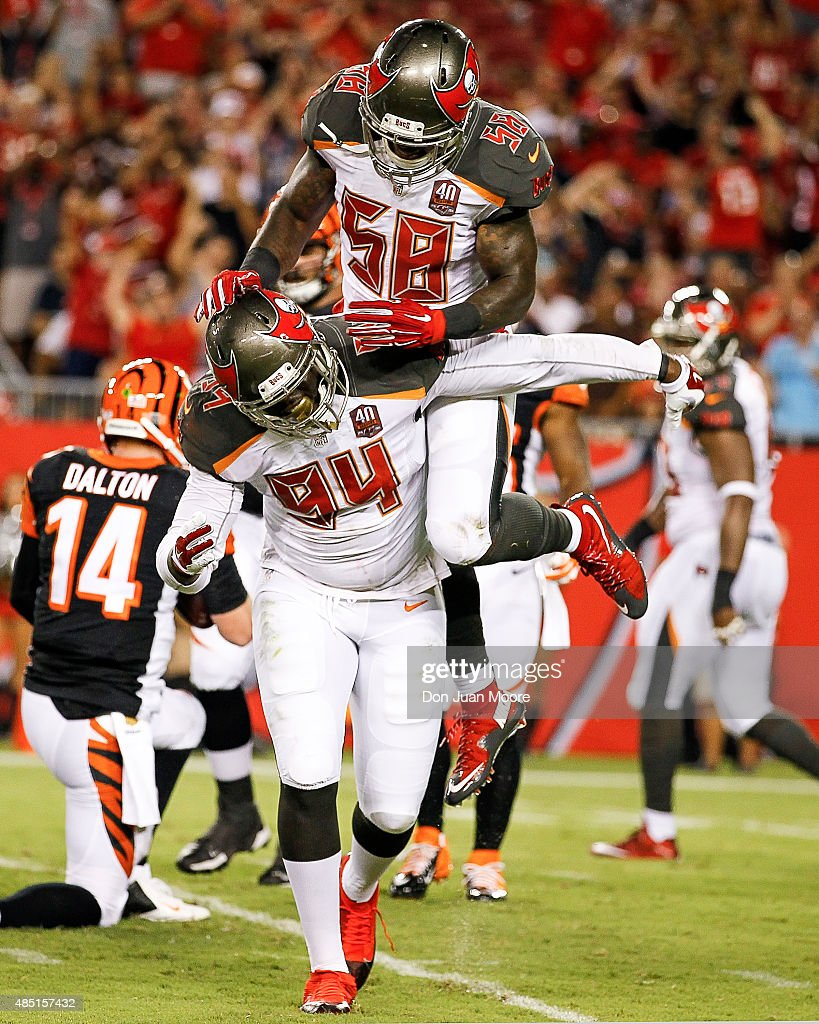 Defensive End George Johnson celebrates with Linebacker Kwon Alexander #58 of the Tampa Bay Buccaneers on a sack during a preseason game against the Cincinnati Bengals at Raymond James Stadium on August 24, 2015 in Tampa, Florida. The Buccaneers defeated the Bengals 25 to 11.