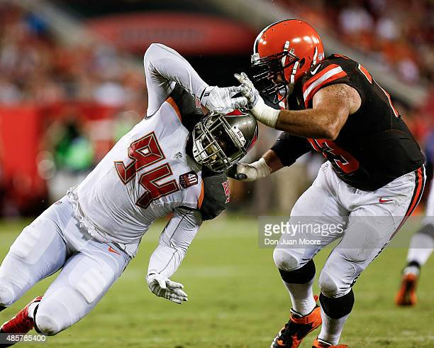 Defensive end George Johnson of the Tampa Bay Buccaneers is being blocked by Tackle Joe Thomas of the Cleveland Browns during a preseason game at...