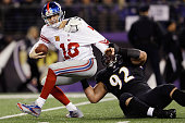 Defensive end Haloti Ngata of the Baltimore Ravens sacks quarterback Eli Manning of the New York Giants during the second quarter at MT Bank Stadium...