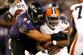 Defensive end Haloti Ngata of the Baltimore Ravens tackles running back Chris Ogbonnaya of the Cleveland Browns during the NFL Game at MT Bank...