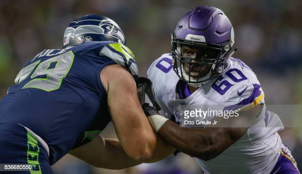 Defensive end Ifeadi Odenigbo of the Minnesota Vikings battles offensive tackle Ethan Pocic of the Seattle Seahawks at CenturyLink Field on August 18...