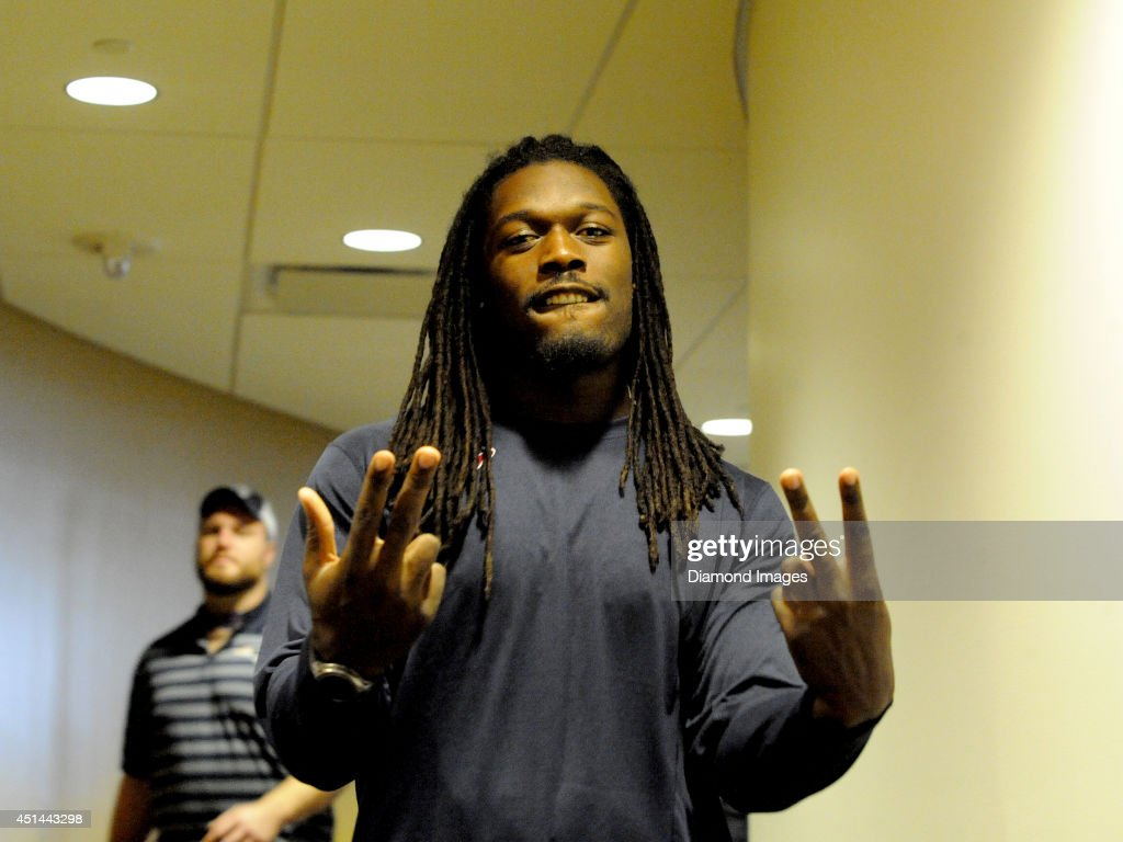 Defensive end Jadaeveon Clowney of the Houston Texans gestures toward the camera while taking a tour of the Pro Football Hall of Fame as part of the 2014 NFL Rookie Symposium in Canton, Ohio on June 28, 2014.