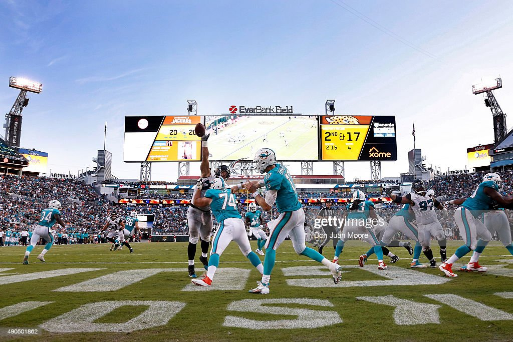 Defensive End Jared Odrick #75 of the Jacksonville Jaguars blocks a pass from Quarterback Ryan Tannehill #7 of the Miami Dolphins in the end zone during the closing minutes of the game at EverBank Field on September 20, 2015 in Jacksonville, Florida. The Jaguars defeated the Dolphins 23 to 20.