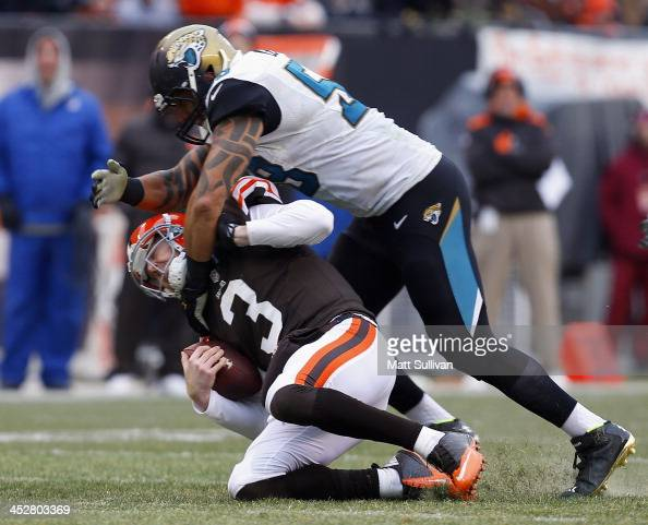 Defensive end Jason Babin of the Jacksonville Jaguars tackles quarterback Brandon Weeden of the Cleveland Browns at FirstEnergy Stadium on December 1...