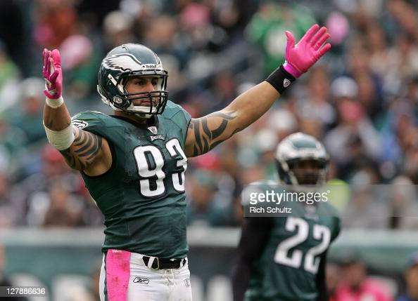 Defensive end Jason Babin of the Philadelphia Eagles raises his arms to get the crowd going against the San Francisco 49ers during an NFL football...