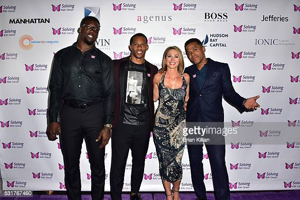 NFL defensive end Jason PierrePaul NFL wide receiver Victor Cruz Amy Robach and recording artist Maxwell attend the 7th Annual Solving Kids' Cancer...