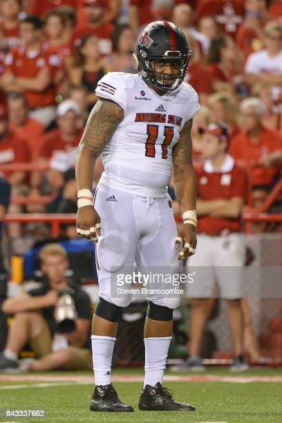 Defensive end Ja'Von RollandJones of the Arkansas State Red Wolves awaits a snap against the Nebraska Cornhuskers at Memorial Stadium on September 2...