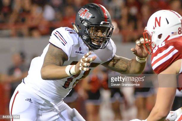 Defensive end Ja'Von RollandJones of the Arkansas State Red Wolves rushes against the Nebraska Cornhuskers at Memorial Stadium on September 2 2017 in...