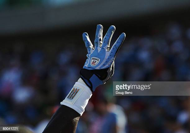 Defensive end Jevon Kearse of the Tennessee Titans holds up four fingers as the crowd shouts '4 and 0' late in the fourth quarter against the...