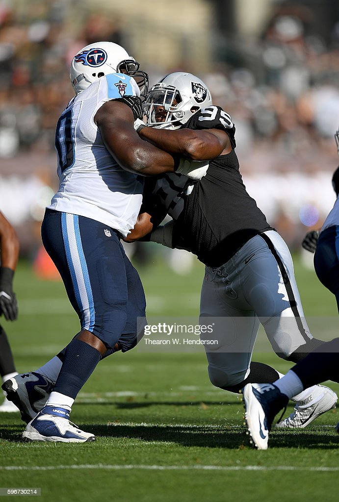 Defensive end Jihad Ward #95 of the Oakland Raiders rushes up against guard Chance Warmack #70 of the Tennessee Titans in the first half of their preseason football game at the Oakland Coliseum on August 27, 2016 in Oakland, California.