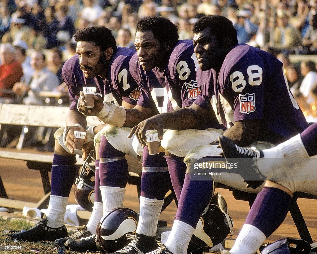 Defensive end Jim Marshall of the Minnesota Vikings sits on the bench next to defensive end Carl Eller and defensive tackle Alan Page against the Los...