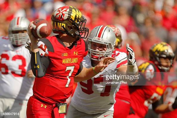 Defensive end Joey Bosa of the Ohio State Buckeyes closes in on quarterback Caleb Rowe of the Maryland Terrapins during the second half of their game...