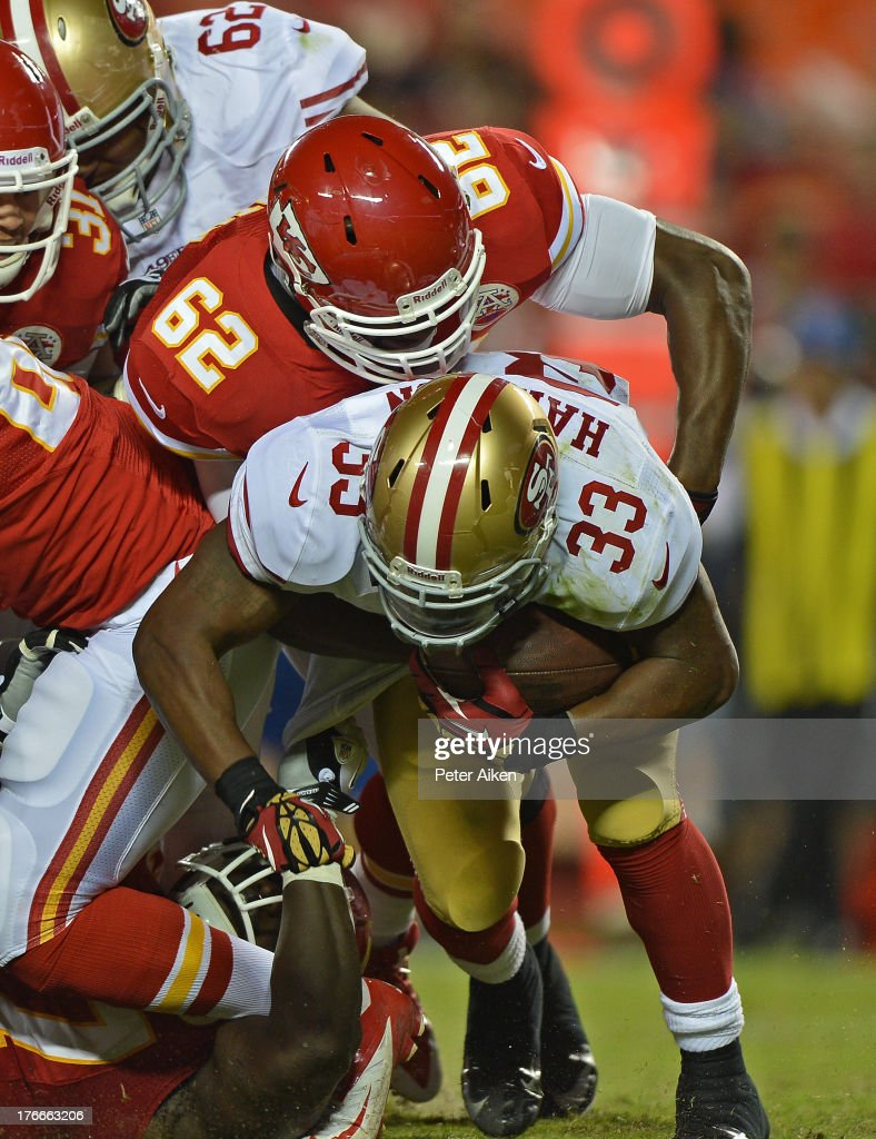 Defensive end Josh Martin #62 of the Kansas City Chiefs tackles running back <a gi-track='captionPersonalityLinkClicked' href=/galleries/search?phrase=Jewel+Hampton&family=editorial&specificpeople=5571691 ng-click='$event.stopPropagation()'>Jewel Hampton</a> #33 of the San Francisco 49ers for a loss during the second half on August 16, 2013 at Arrowhead Stadium in Kansas City, Missouri. The 49ers won 15-13.