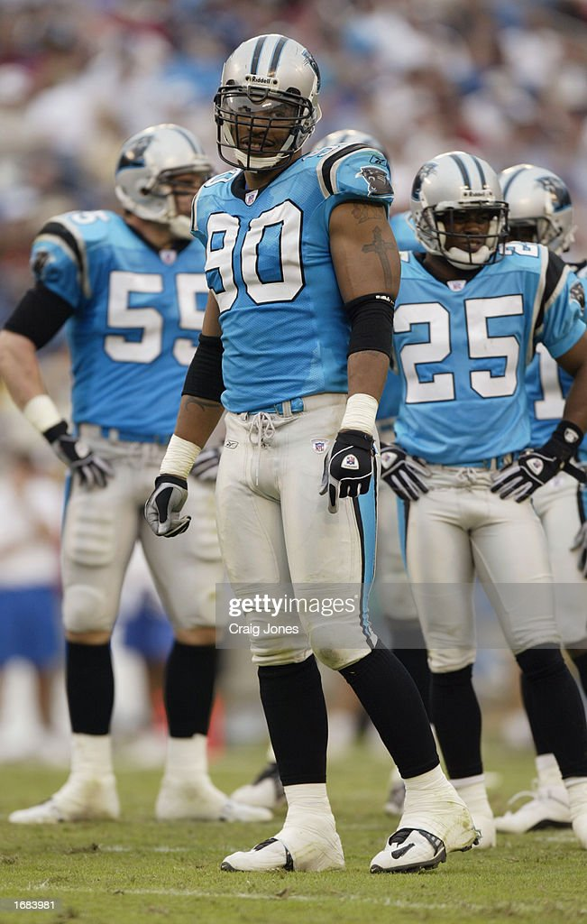 Defensive End Julius Peppers #90 of the Carolina Panthers looks on against the Tampa Bay Buccaneers during the NFL game at Ericsson Stadium on October 27, 2002 in Charlotte, North Carolina. The Buccaneers won 12-9.