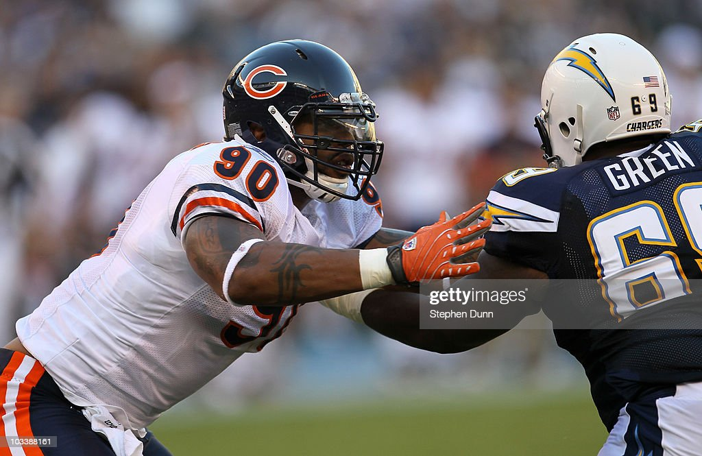 Defensive end Julius Peppers of the Chicago Bears battles offensive guard Tyrondne Green of the San Diego Chargers on August 14 2010 at Qualcomm...
