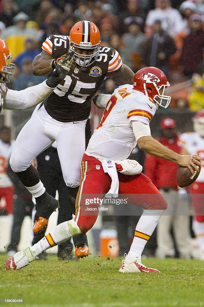 Defensive end Juqua Parker #95 of the Cleveland Browns sacks quarterback Brady Quinn #9 of the Kansas City Chiefs during the second half at Cleveland Browns Stadium on December 9, 2012 in Cleveland, Ohio. The Browns defeated the Chiefs 30-7.