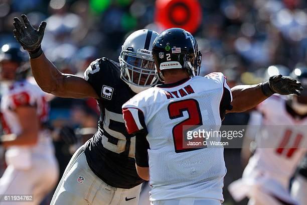 Defensive end Khalil Mack of the Oakland Raiders pressures quarterback Matt Ryan of the Atlanta Falcons during the fourth quarter at OaklandAlameda...