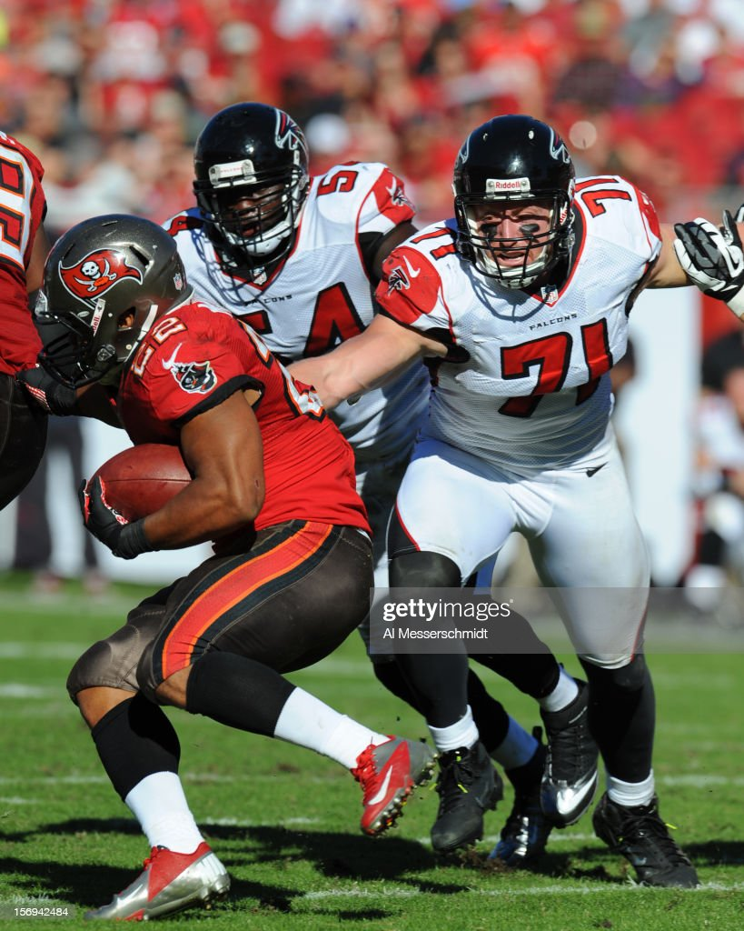 Defensive end Kroy Biermann #71 of the Atlanta Falcons stretches to tackle running back <a gi-track='captionPersonalityLinkClicked' href=/galleries/search?phrase=Doug+Martin+-+American+Football+Running+Back&family=editorial&specificpeople=9693143 ng-click='$event.stopPropagation()'>Doug Martin</a> #22 of the Tampa Bay Buccaneers November 25, 2012 at Raymond James Stadium in Tampa, Florida. The Falcons won 24 - 23.