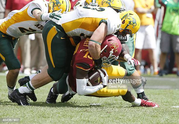 Defensive end Kyle Emanuel of the North Dakota State Bison tackles wide receiver Dondre Daley of the Iowa State Cyclones in the second half of play...