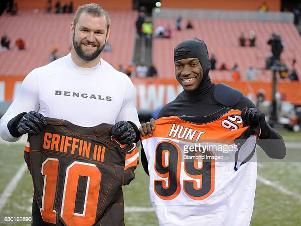 Defensive end Margus Hunt of the Cincinnati Bengals and quarterback Robert Griffin III of the Cleveland Browns pose for a picture as they exchange...