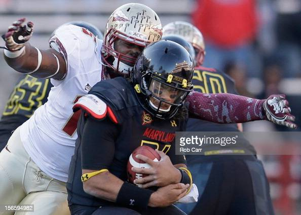 Defensive end Mario Edwards Jr #15 of the Florida State Seminoles sacks quarterback Shawn Petty of the Maryland Terrapins during the fourth quarter...
