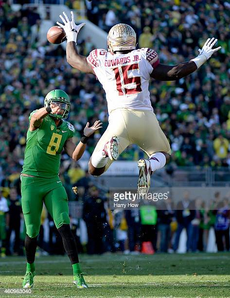 Defensive end Mario Edwards Jr #15 of the Florida State Seminoles attempts to block a pass by quarterback Marcus Mariota of the Oregon Ducks during...