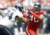 Defensive end Mario Williams of the Houston Texans battles with offensive tackle Maurice Williams of the Jacksonville Jaguars at Reliant Stadium on...