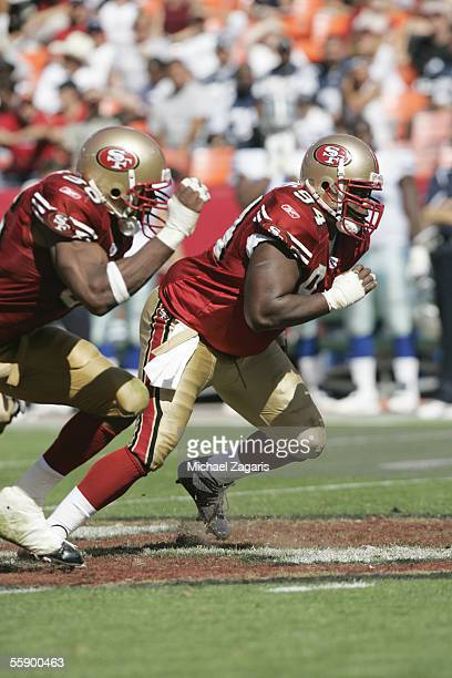 Defensive end Marques Douglas of the San Francisco 49ers defends against the Dallas Cowboys at Monster Park on September 25 2005 in San Francisco...