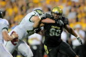 Defensive end Marquez Herrod of the Colorado Buffaloes rushes the quarterback against the block of offensive tackle Mark Starr of the Colorado State...