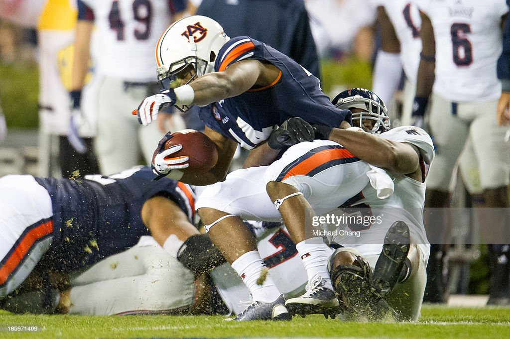 Defensive end Martin Wright #5 of the Florida Atlantic Owls drags quarterback Nick Marshall #14 of the Auburn Tigers to the ground during the first quarter of play on October 26, 2013 at Jordan-Hare Stadium in Auburn, Alabama. At the end of the first quarter Auburn leads Florida Atlantic 21-0.