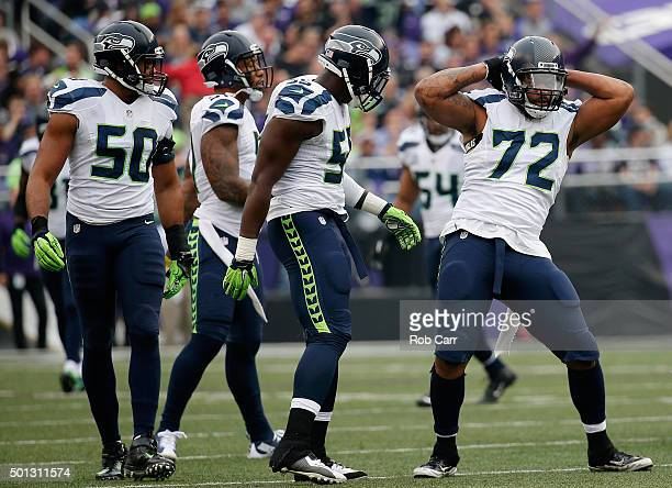 Defensive end Michael Bennett of the Seattle Seahawks celebrates after making a first half tackle against the Baltimore Ravens at MT Bank Stadium on...