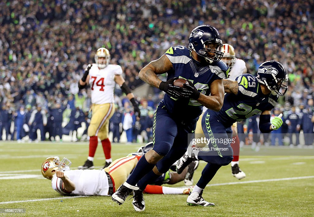 Defensive end Michael Bennett #72 of the Seattle Seahawks recovers a fumble by quarterback Colin Kaepernick #7 of the San Francisco 49ers and runs for 17-yards in the fourth quarter during the 2014 NFC Championship at CenturyLink Field on January 19, 2014 in Seattle, Washington.