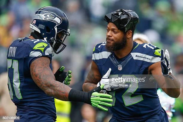 Defensive end Michael Bennett of the Seattle Seahawks sports a Darth Vader mask as he is greeted by linebacker Bruce Irvin during introductions prior...