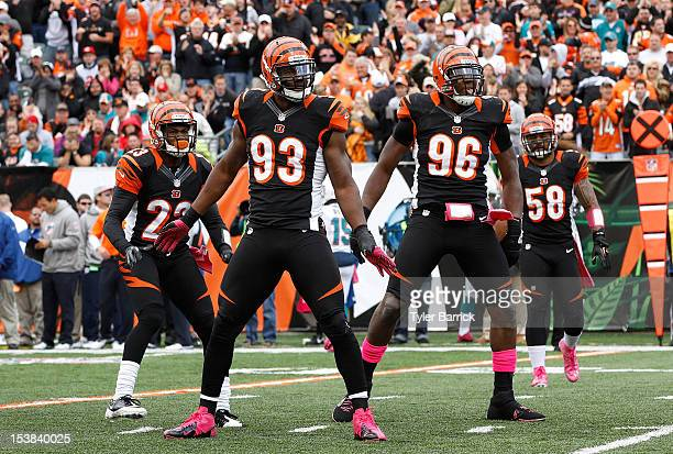Defensive end Michael Johnson #93 of the Cincinnati Bengals celebrates with teammates Carlos Dunlap Terence Newman and Rey Maualuga after stopping a...