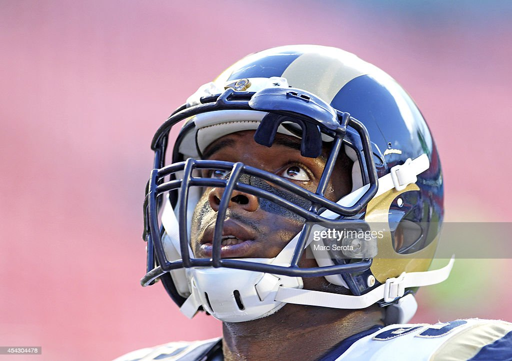 Defensive end <a gi-track='captionPersonalityLinkClicked' href=/galleries/search?phrase=Michael+Sam&family=editorial&specificpeople=7172674 ng-click='$event.stopPropagation()'>Michael Sam</a> #96 of the St. Louis Rams looks up during pregame workouts before his team met the Miami Dolphins at Sun Life Stadium on August 28, 2014 in Miami Gardens, Florida.